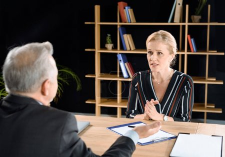 woman asking businessman for advice
