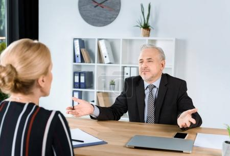 Photo for Mature business colleagues talking in modern office - Royalty Free Image