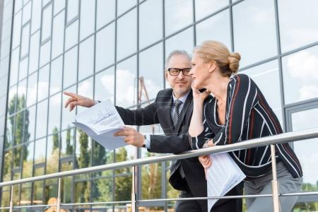 business colleagues with documents