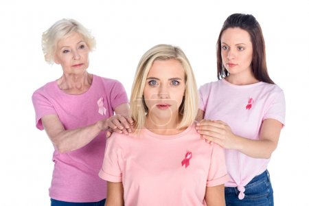 women in pink t-shirts with ribbons