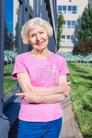 senior woman in pink t-shirt