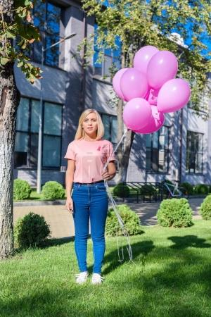 young woman with pink balloons
