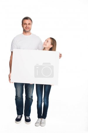 daughter and father with empty banner