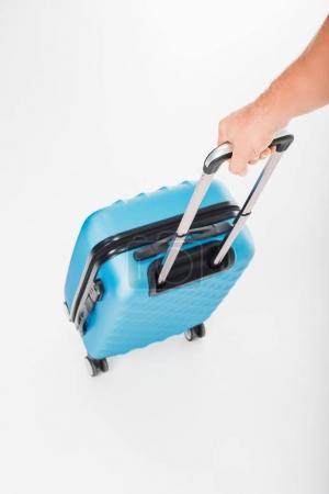 Hand holding luggage bag