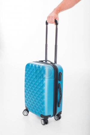 hand holding luggage bag