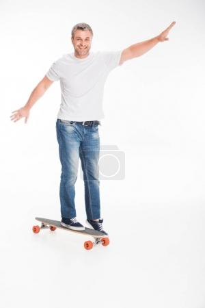 male skateboarder on longboard