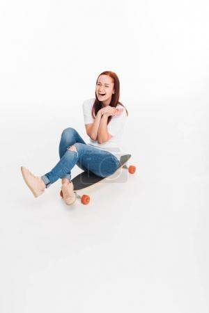 female skateboarder on longboard
