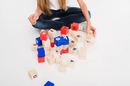 child with alphabet blocks