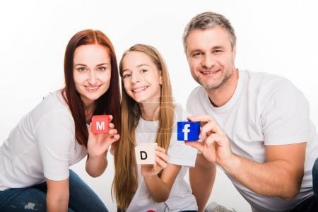 Family showing alphabet blocks