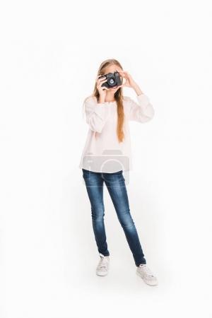 Photo for Female child taking photo on camera, isolated on white - Royalty Free Image