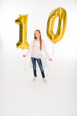 Photo for Adorable happy female child holding golden balloons with number ten for birthday, isolated on white - Royalty Free Image