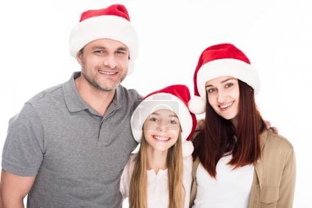 familia en gorros de santa