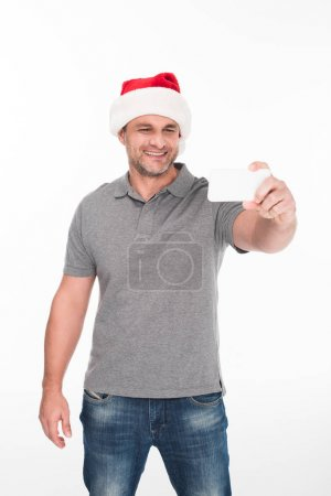 man in santa hat taking selfie