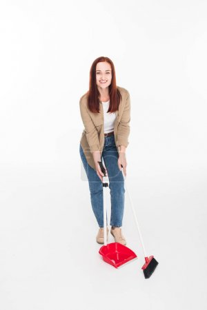 woman sweeping with broom