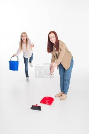 family cleaning with broom