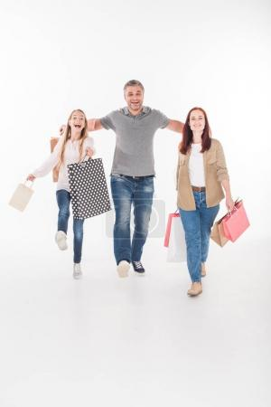 family with shopping bags