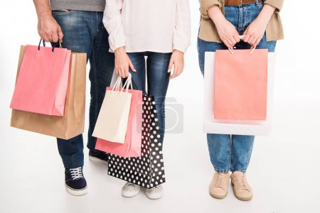Photo for Cropped view of family with shopping bags, isolated on white - Royalty Free Image