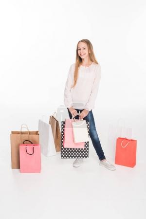 female teenager with shopping bags
