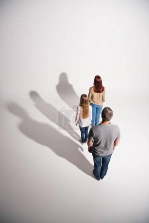 Young family with shadows