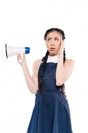 confused asian woman with loudspeaker