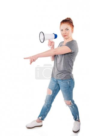 Photo for Side view of shocked woman with megaphone pointing away isolated on white - Royalty Free Image