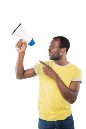 Photo for Portrait of angry african american man with bullhorn pointing away isolated on white - Royalty Free Image