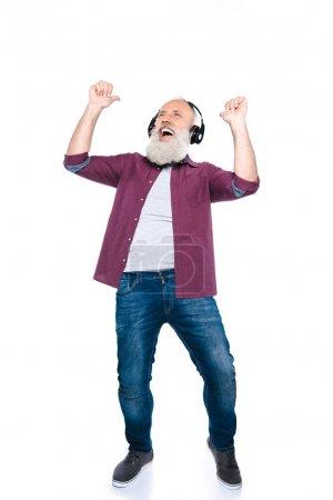 senior man dancing with headphones