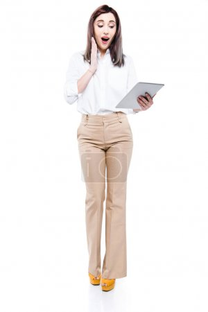 excited businesswoman with digital tablet