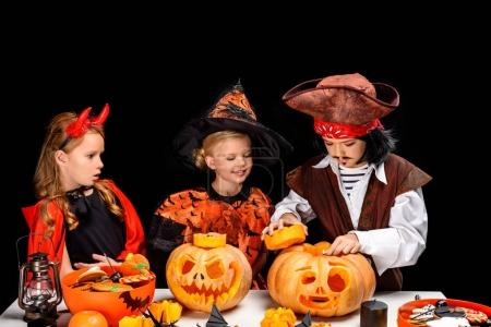 Kids with halloween jack o lanterns