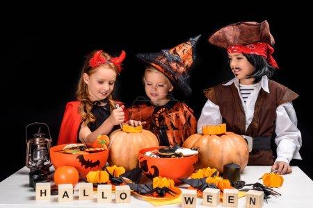 Children making halloween jack o lanterns