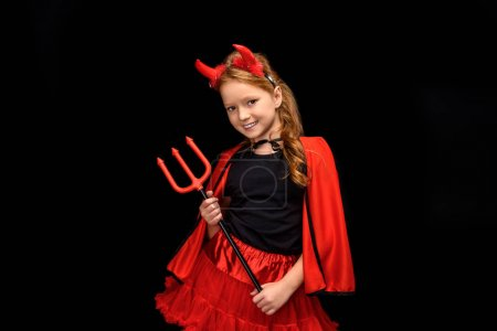 Child in halloween costume of devil with pitchfork...