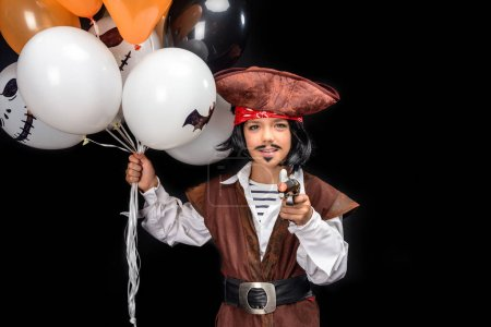 Little pirate with gun and balloons
