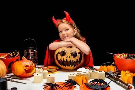 little devil with jack o lantern