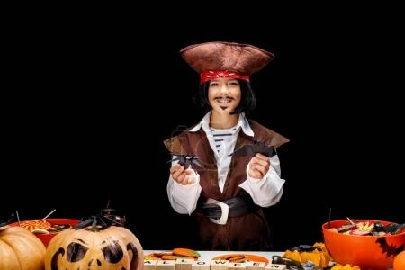 child with halloween decorations