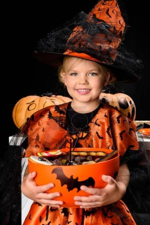 little witch with halloween sweets