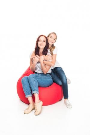 mother and daughter on bean bag chair