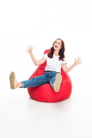 excited woman on bean bag chair