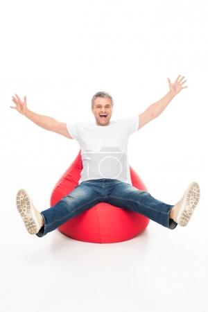 excited man on bean bag chair