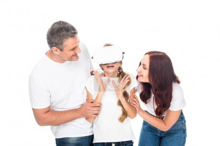 Photo for Excited family using virtual reality headset, isolated on white - Royalty Free Image