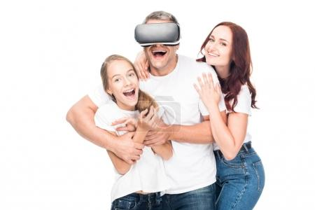 Photo for Excited family hugging and using virtual reality headset, isolated on white - Royalty Free Image