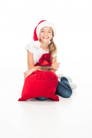 smiling teenager with Christmas bag