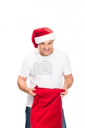 man in Santa hat with bag