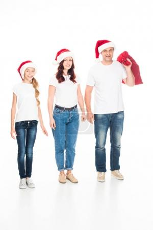 family with Christmas bag