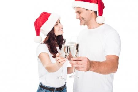 couple clinking with champagne glasses