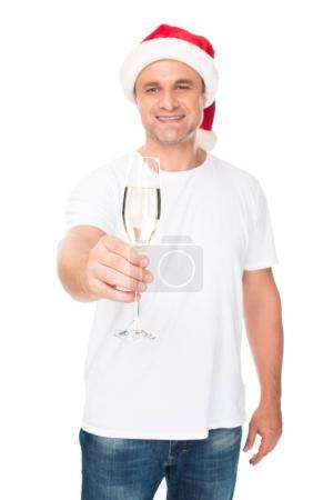 man in Santa hat with champagne
