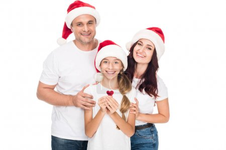 Happy family in Santa hats