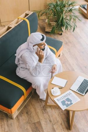 Muslim businessman talking by phone