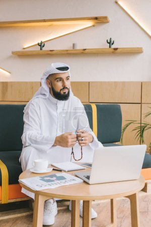 muslim businessman sitting on sofa