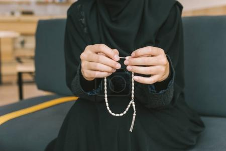 Photo for Cropped shot of muslim woman with prayer beads - Royalty Free Image
