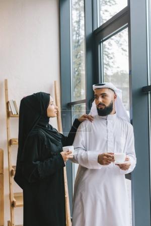 muslim couple drinking coffee